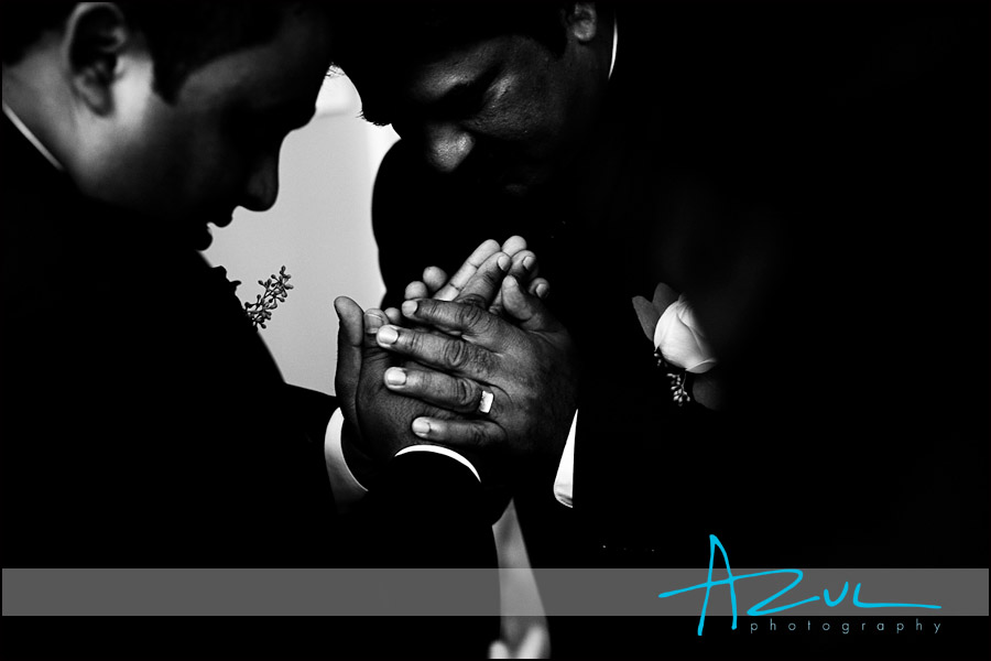 Hands cross in prayer before the wedding ceremony