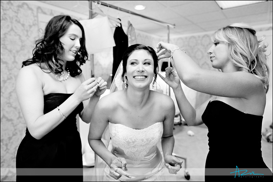 Getting ready photography for wedding with the happy bride in Raleigh NC