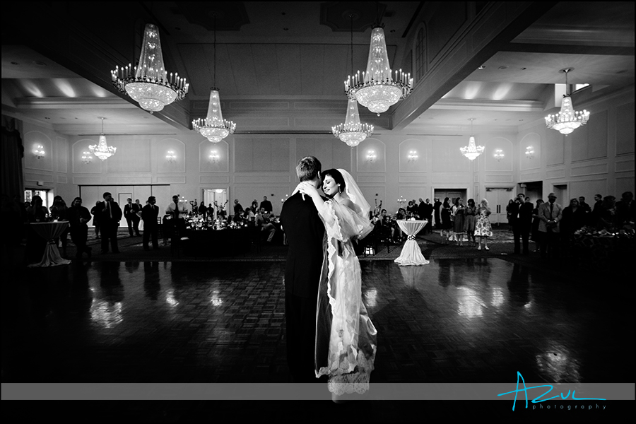 Stunning wedding day photographer lighting at reception in Raleigh