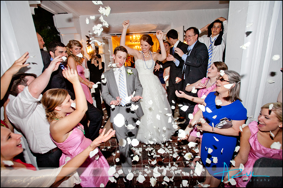Fun wedding day exit from reception photography Raleigh NC