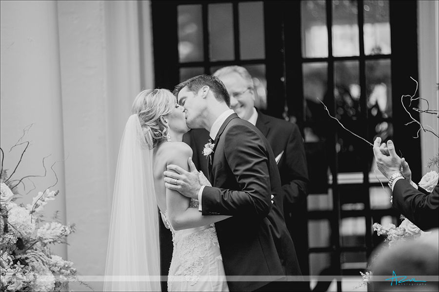 Kissing at The Carolina Inn during the wedding ceremony