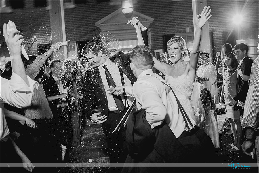 Best wedding reception exit photography with confetti snow in Chapel Hill NC