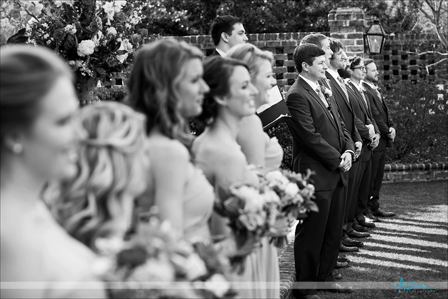 Groom, groomsmen and bridesmaids line up during the ceremony Raleigh NC