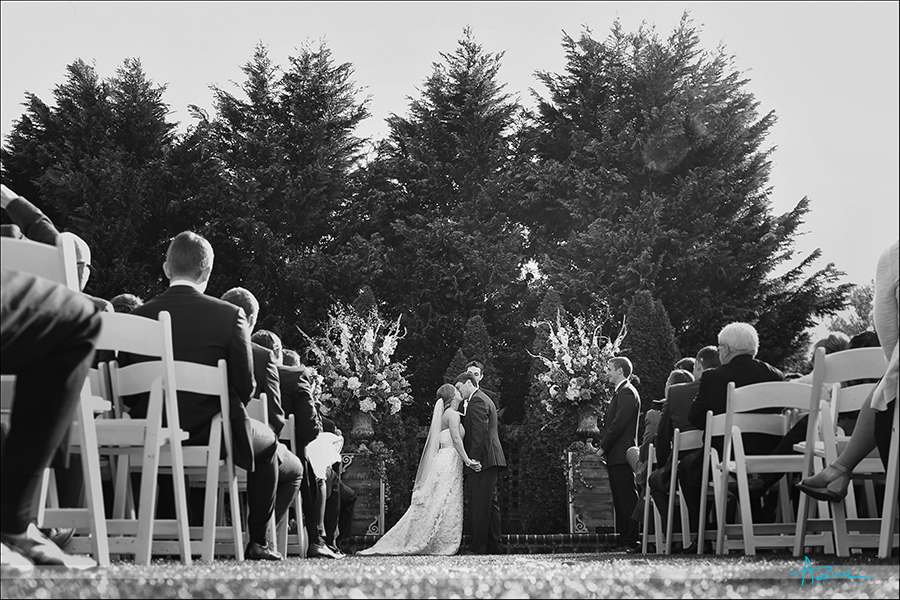 A different type of wedding photographer shooting the kiss in Wake forest NC at The Sutherland