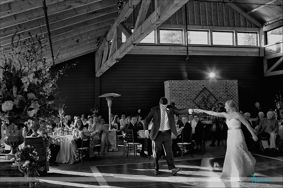 First dance moment of bride and groom on the dance floor at The sutherland NC
