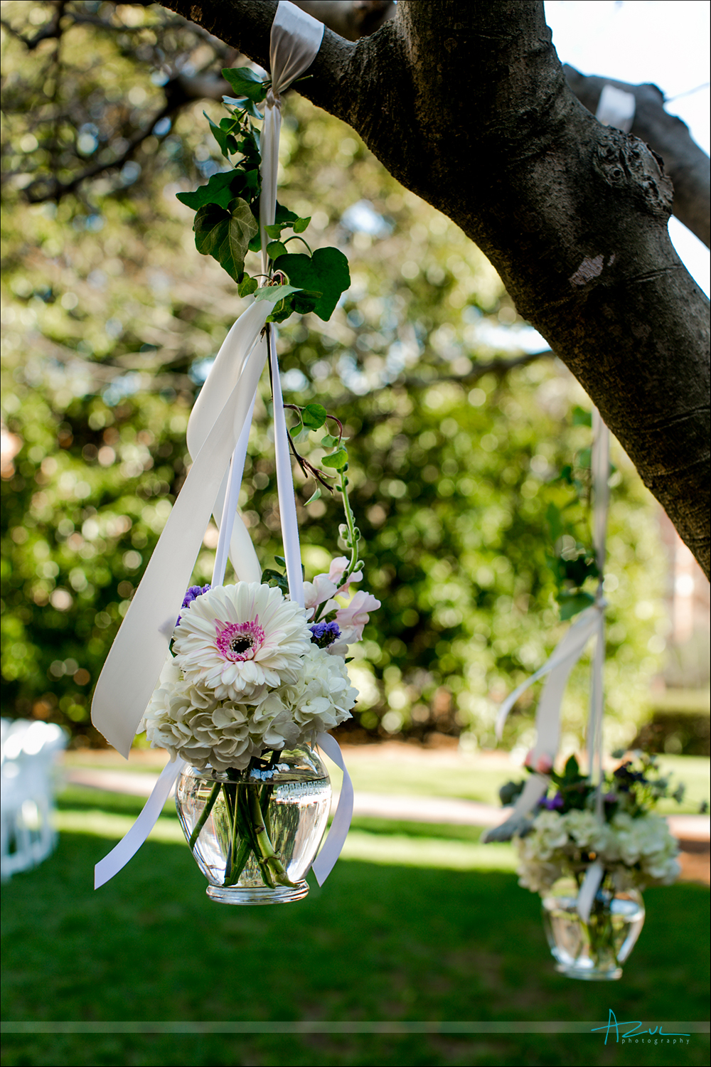 Beautiful wedding day florals hanging from trees, Chapel Hill NC