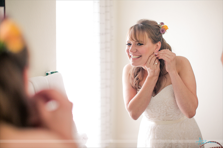 Beautiful bride getting ready in perfect light for wedding photographer