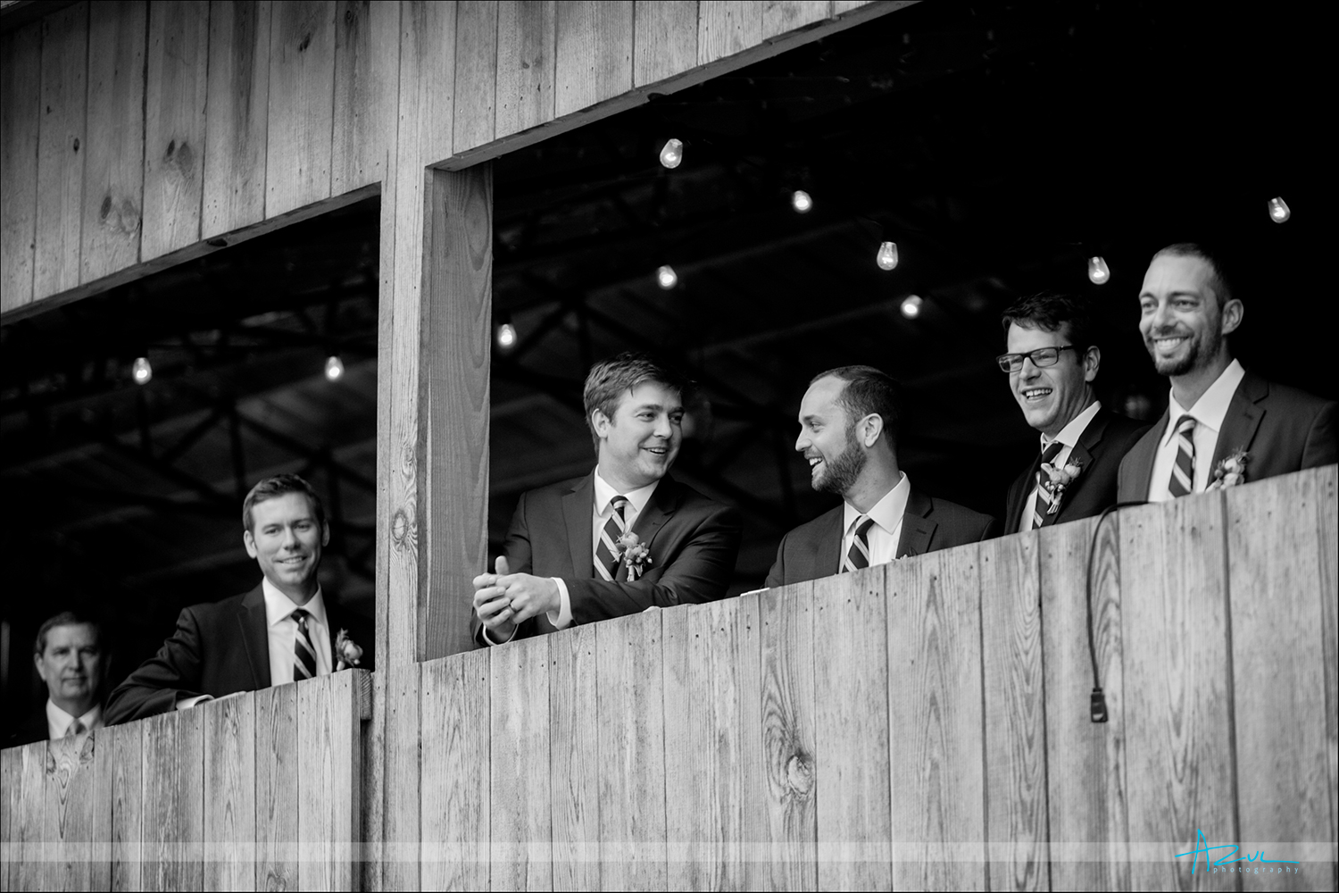 Barn style wedding photography of groom and his men