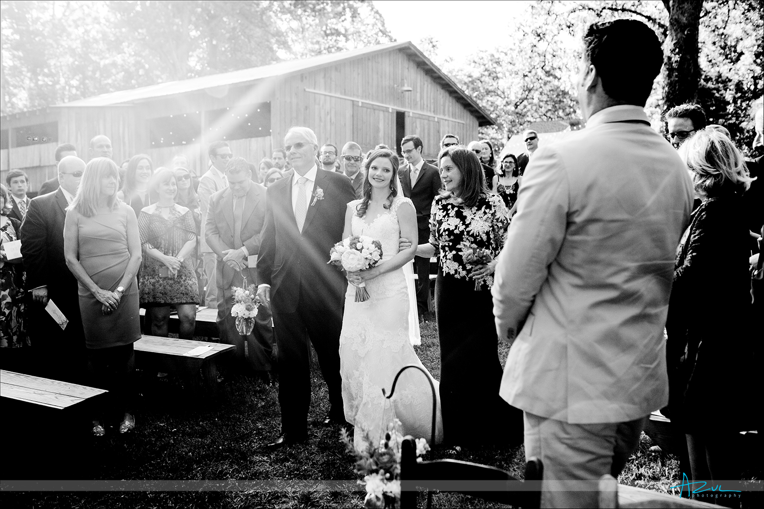 Wedding day ceremony photography with backlit sun in B&W at Rock Quarry Farm in NC