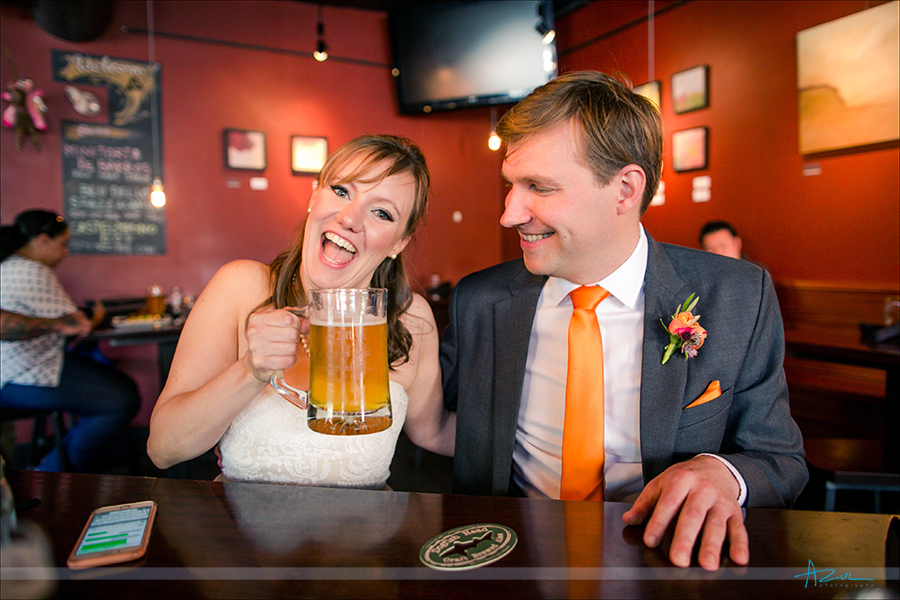Best way to have a good time at a wedding is having a beer prior. This photograph is the bride and groom sharing a beer.