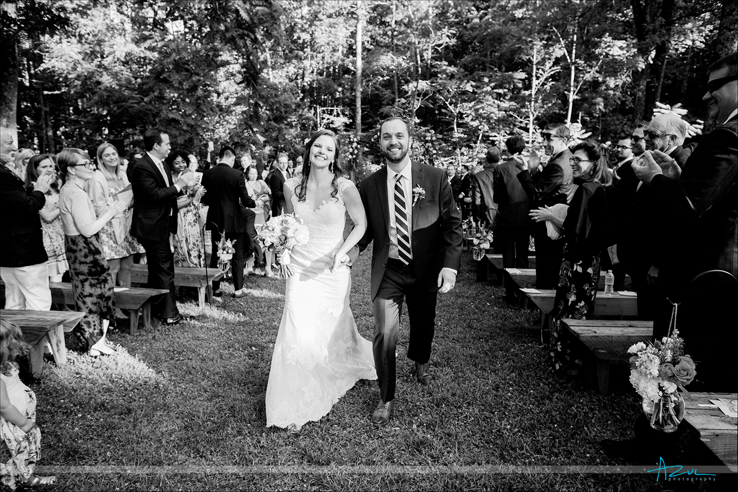 Wedding day ceremony ending as bride and groom walk down the aisle together in Chapel Hill NC