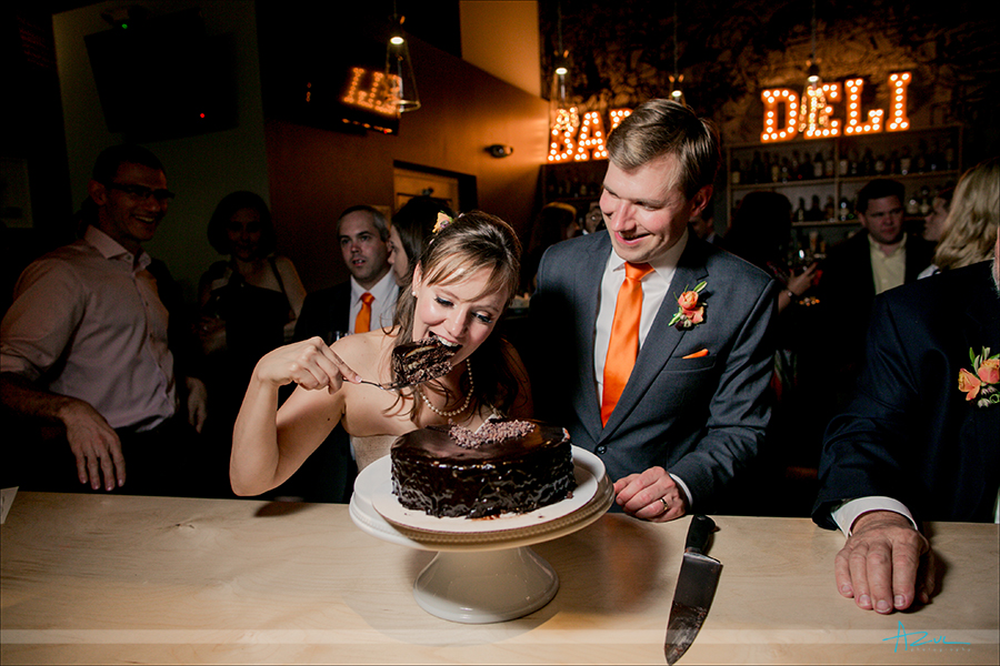 Best cake cutting photograph of the bride devouring cake on her wedding day.