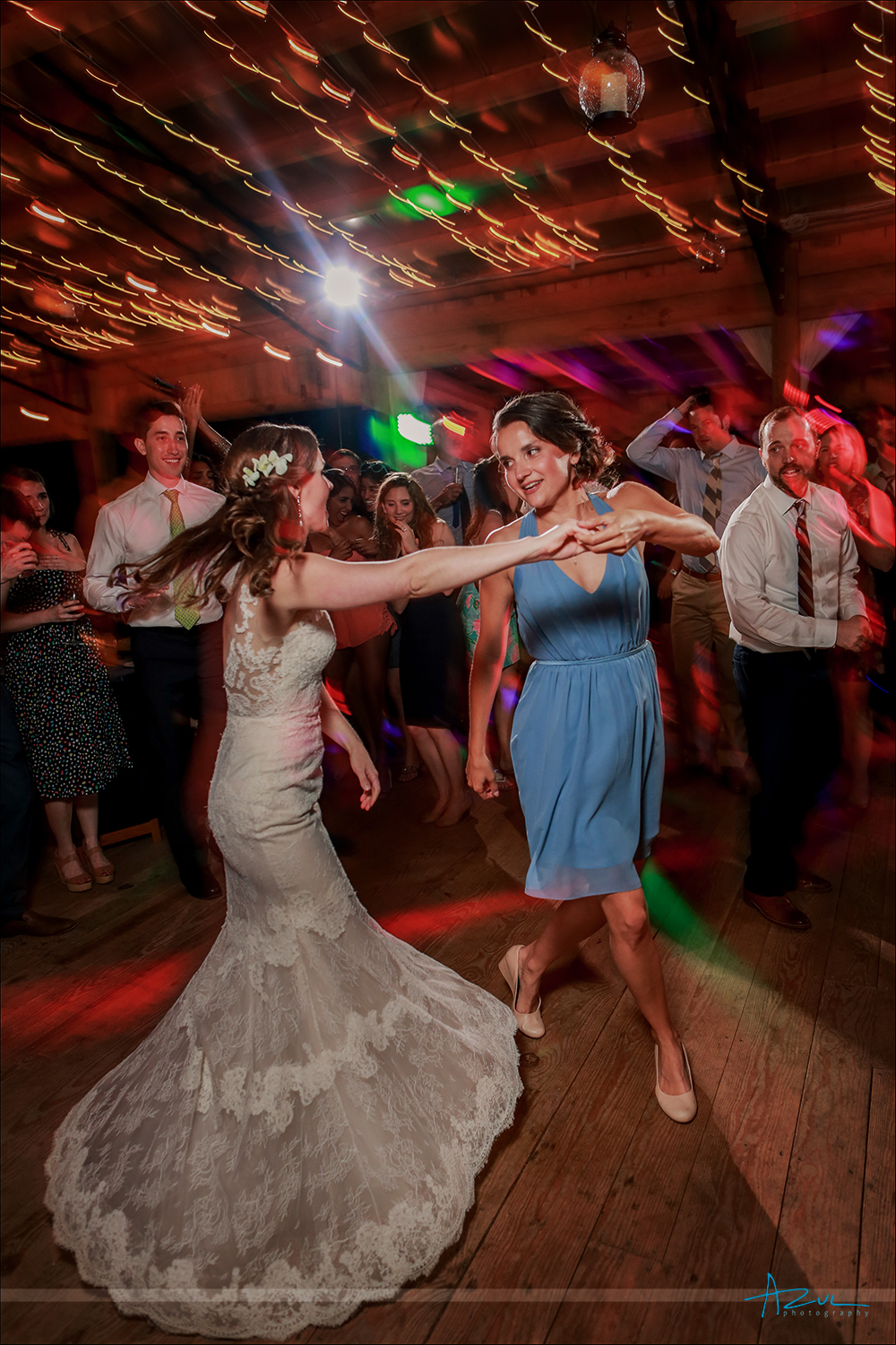 Family wedding reception dancing in North Carolina inside a barn with great lighting by the photographer.