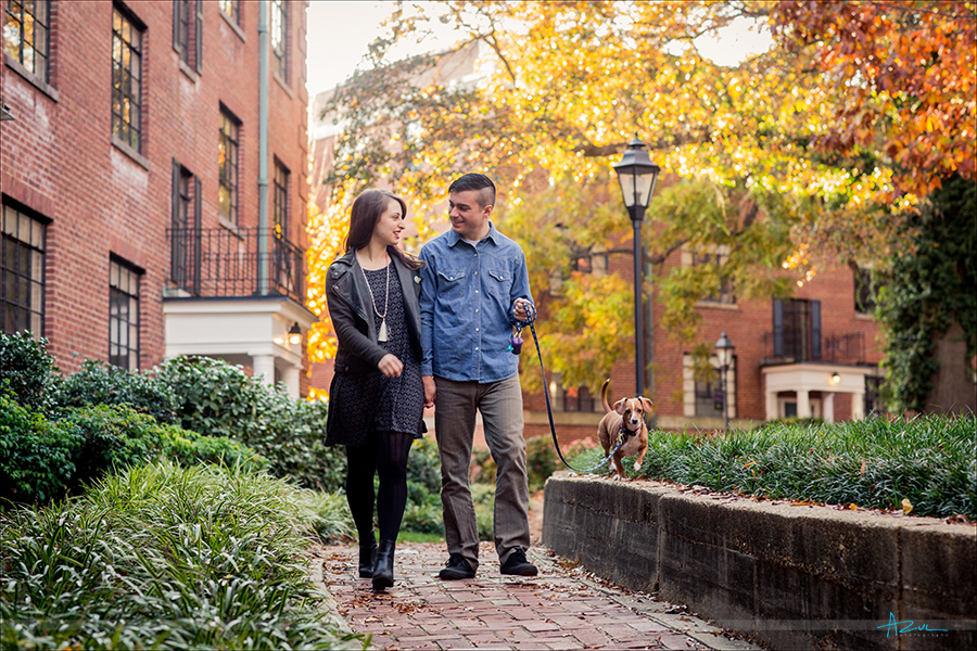 The couple walking together during their engagement portrait session