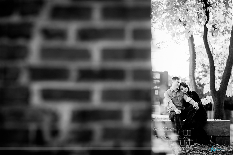 Rustic urban engagement photography portrait session with emotion of couple in downtown Raleigh