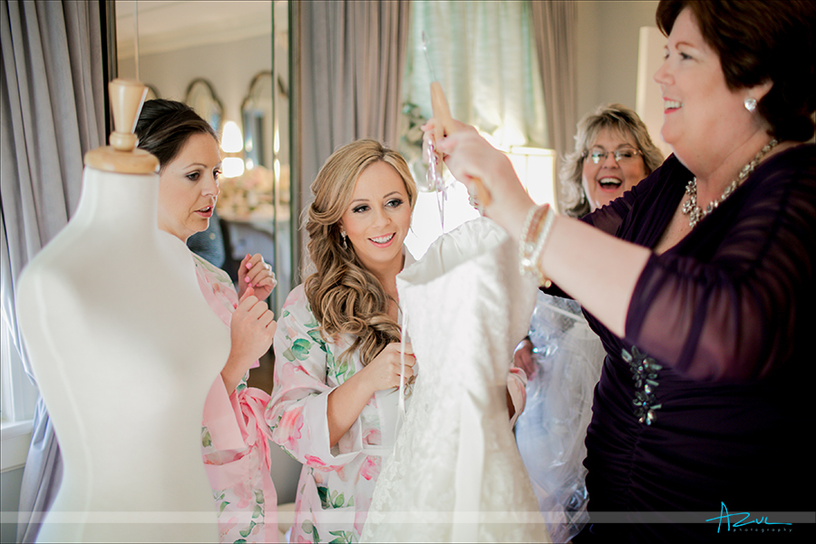On the wedding day the bride and her mom has a candid photograph taken of them together, at Highgrove Estate in NC
