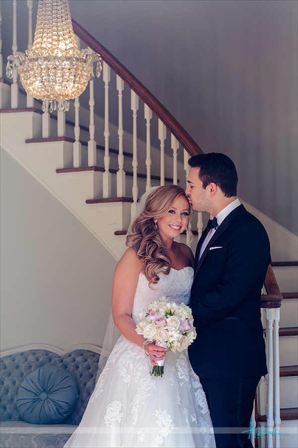 Kissing the bride on the forehead is always a beautiful portrait option for the wedding photograper in North Carolina.