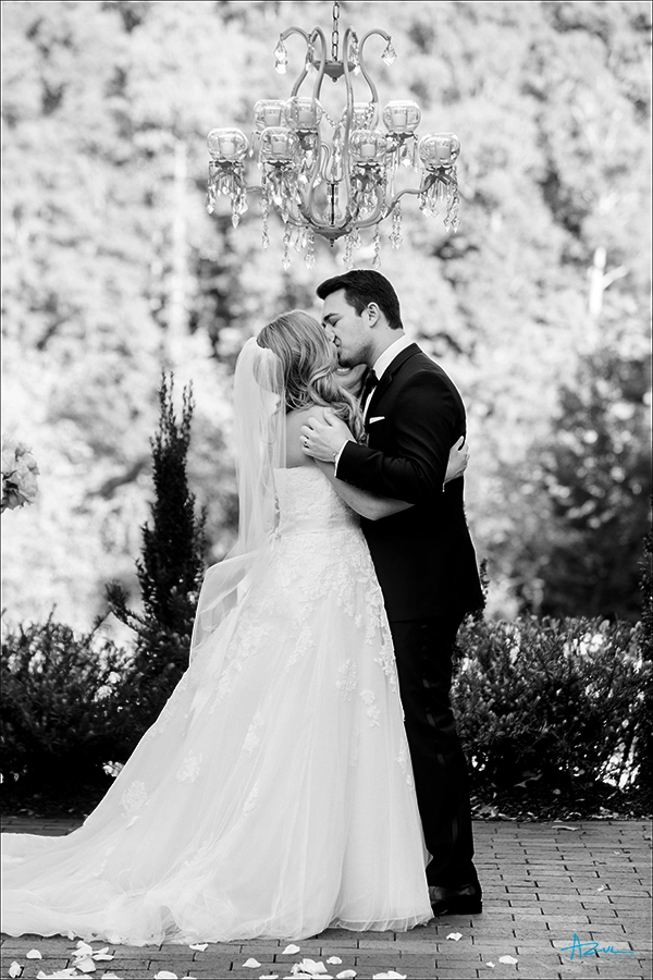 Best advice from this NC wedding photographer on the ceremony kiss is to hold her and kiss longer than you think.