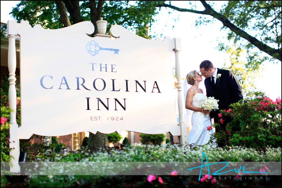 Bride & groom at the Carolina Inn sign.
