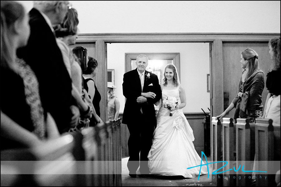 Photographic Moment of Bride walking down the aisle