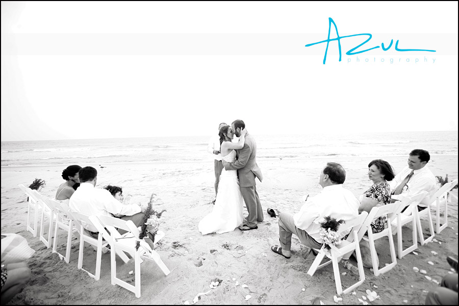 Wedding ceremony kiss on Ockracoke in the Outer Banks.