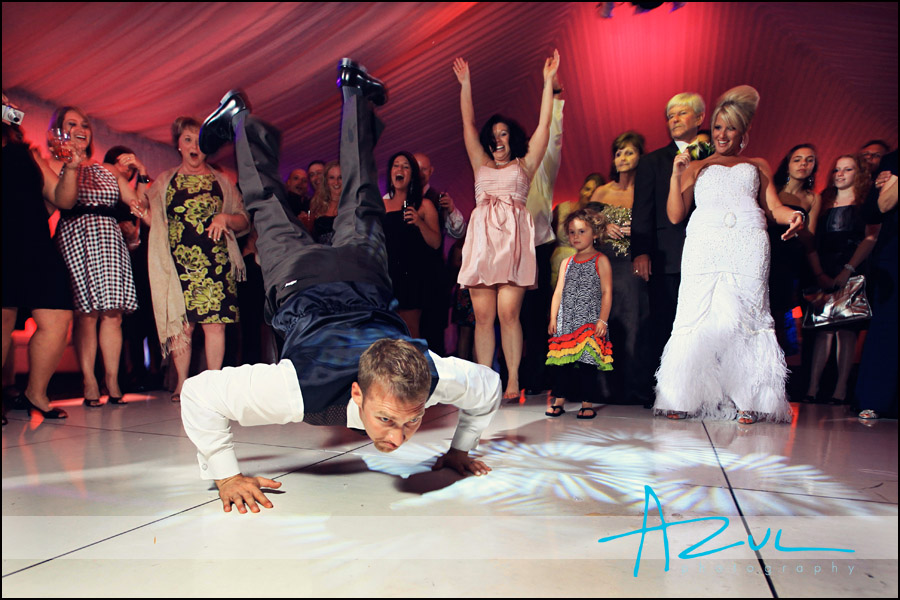 Best man dances during reception at The Grand Marquise