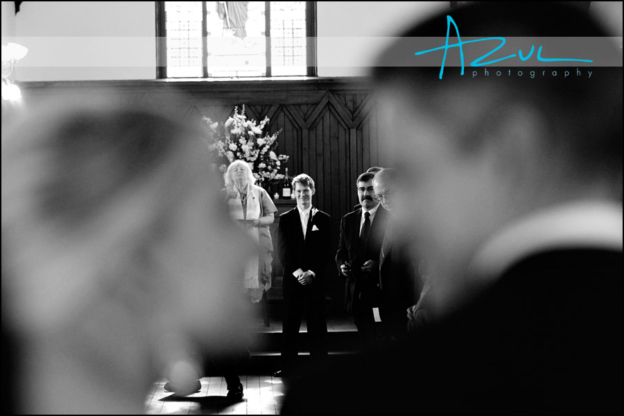 Downtown Raleigh wedding photogaph of bride walking down aisle.
