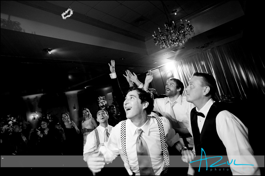Action photography of the toss during a Raleigh wedding reception