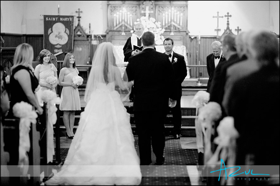 Groom waits for bride at St. Mary's Chapel near downtown Raleigh