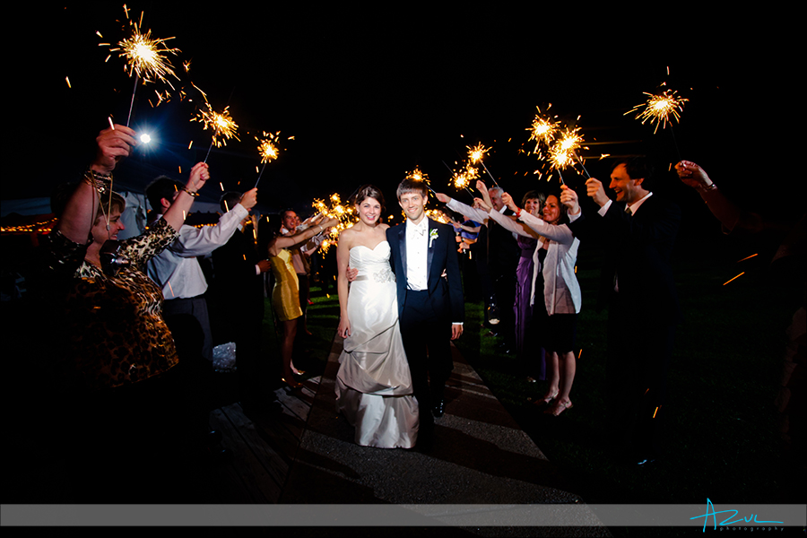 Wedding day exit with sparklers in the Outerbanks Whalehead Club NC