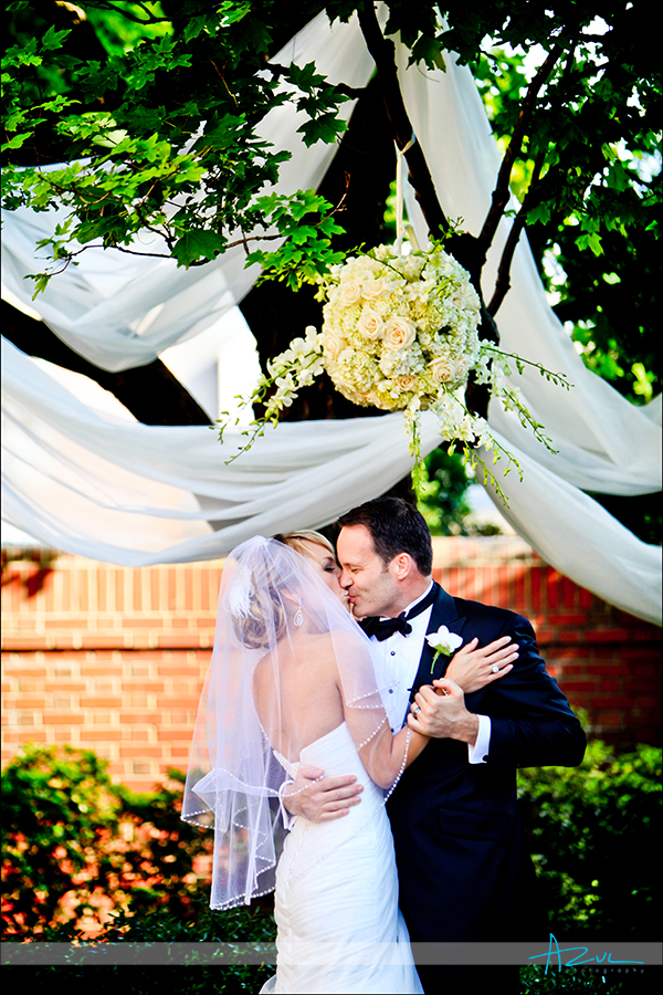 Carolina Inn wedding day kiss Bryant Courtyard Chapel Hill NC