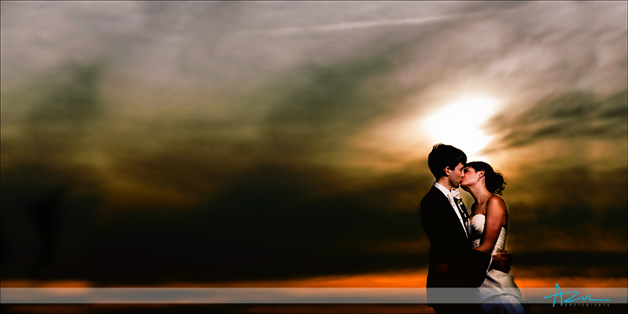 Outer Banks NC Whalehead Club kiss at sunset wedding photographer