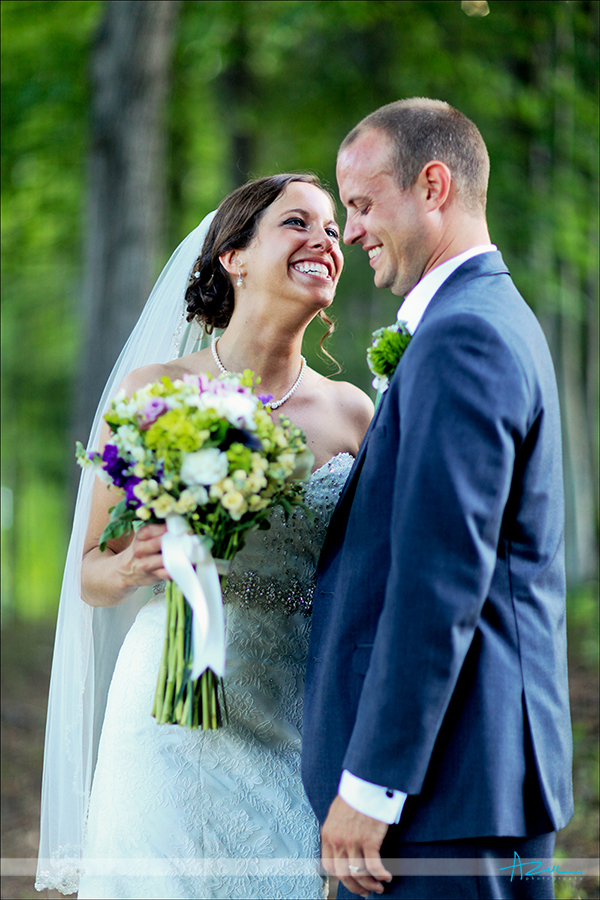 Cute creative wedding day portrait of the bride and groom at Lake Lure NC