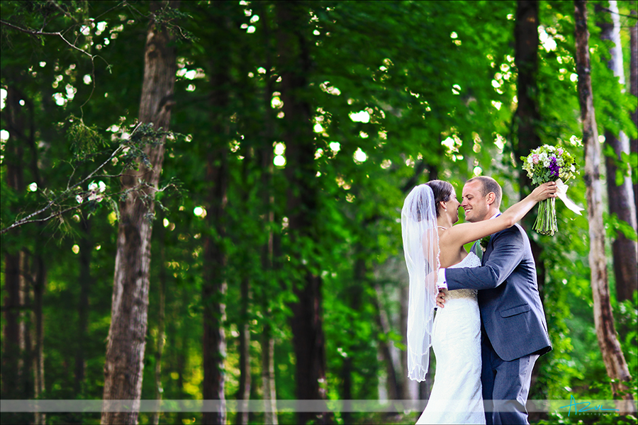 Happy bride & groom during portraits after a beautiful ceremony at Lake Lure NC