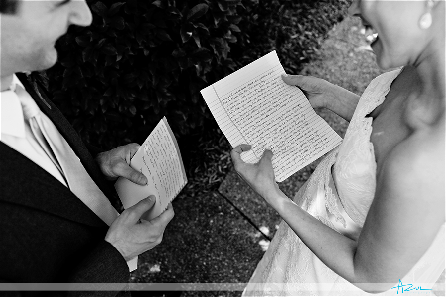 Photography of bride and groom letter exchange on wedding day Raleigh NC