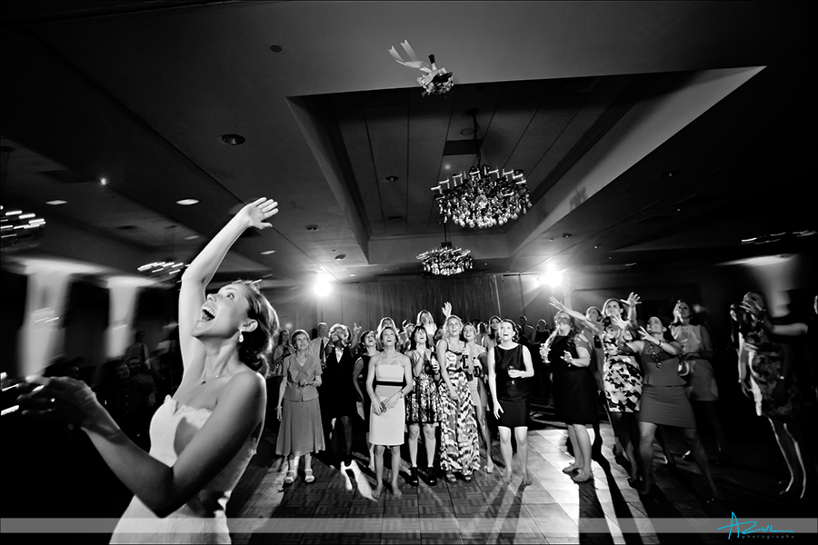 dynamic bouquet toss photography at Raleigh NC Brier Creek Country Club