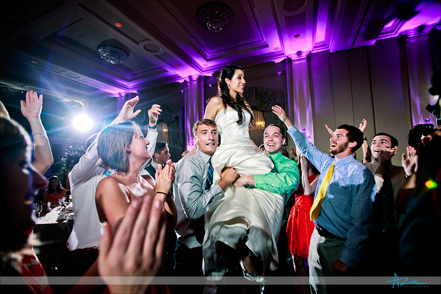 High energy wedding day dancing photography  in the ballroom of Prestonwood CC in Cary NC
