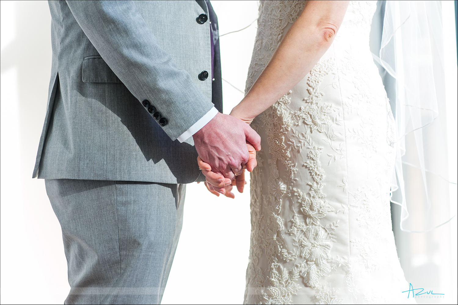 Bride and groom holding hands detail wedding day Raleigh NC