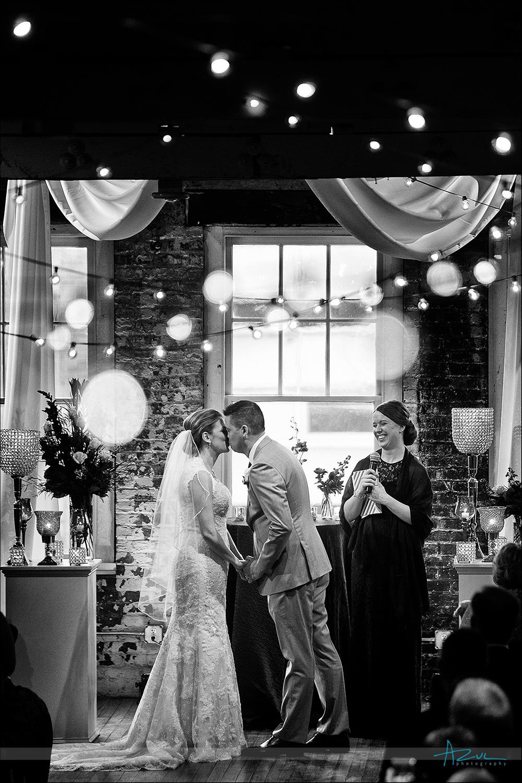 Raleigh Wedding Photographer kiss at The Stockroom, Raleigh NC