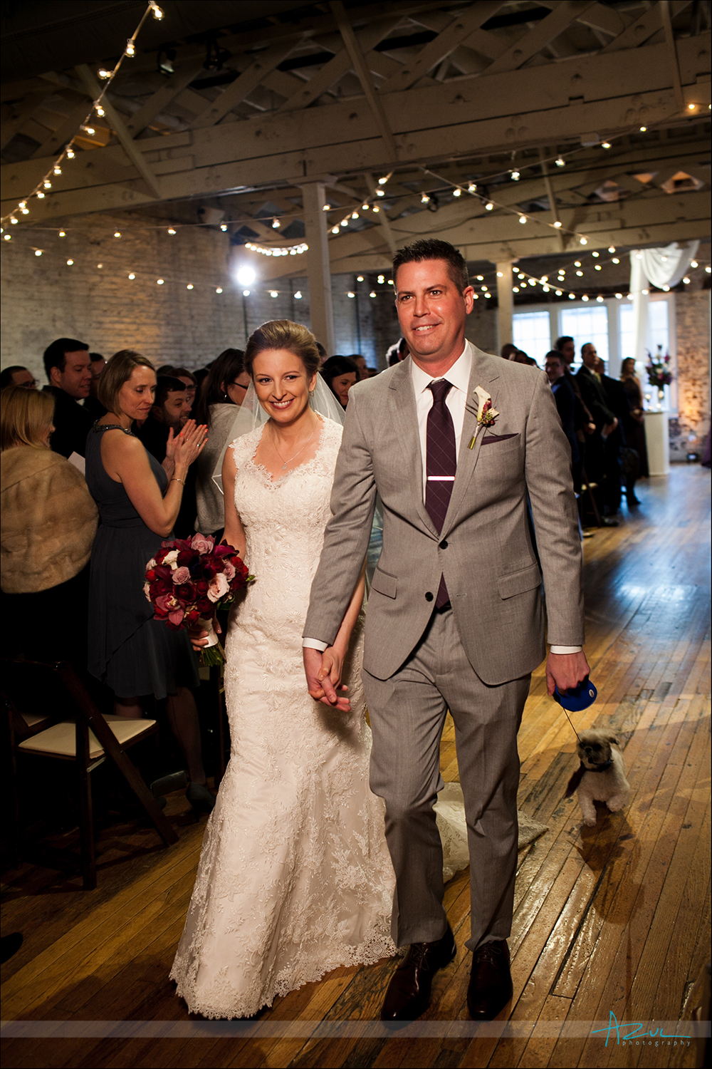 End of ceremony photograph of bride and groom at The Stockroom in Raleigh