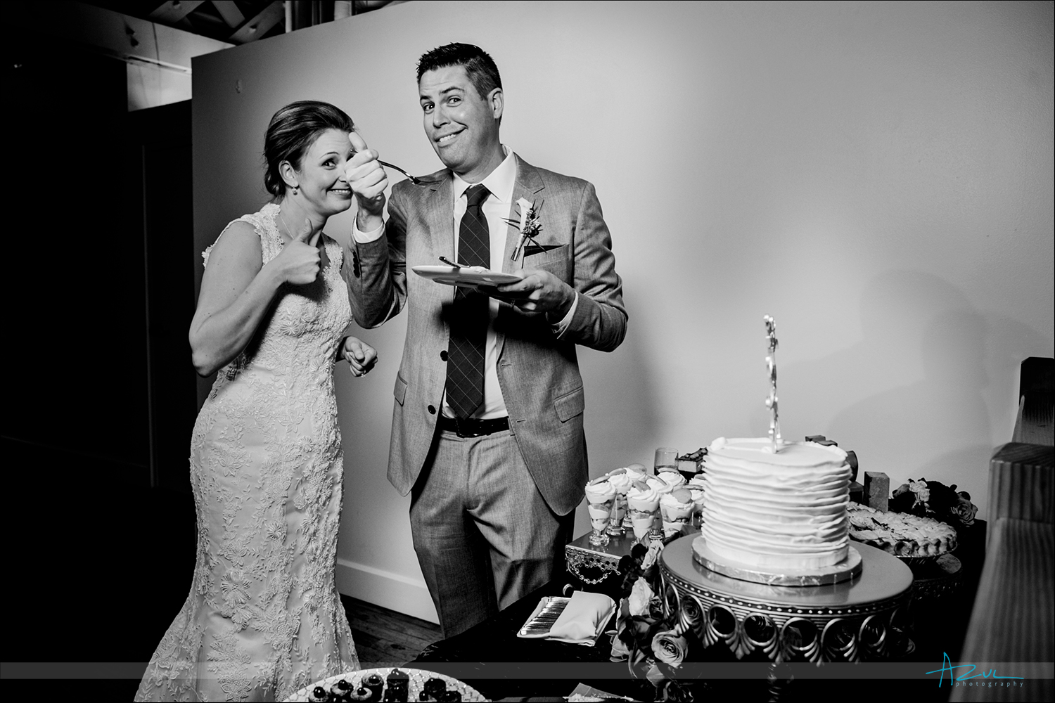 Cute wedding day cake cutting photograph at The Stockroom in Raleigh, North Carolina