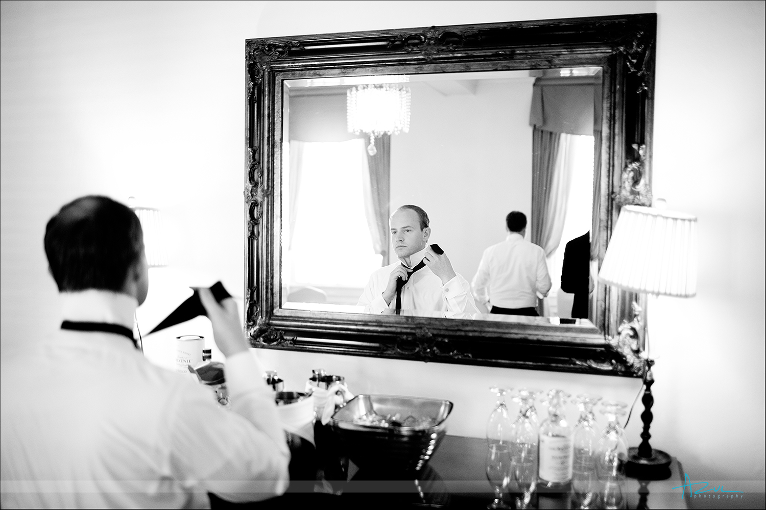 Photography of groom in mirror prior to wedding ceremony at The Carolina Inn NC