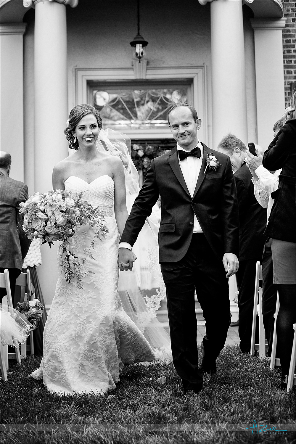 Husband and wife walking down the aisle after wedding in Chapel Hill NC