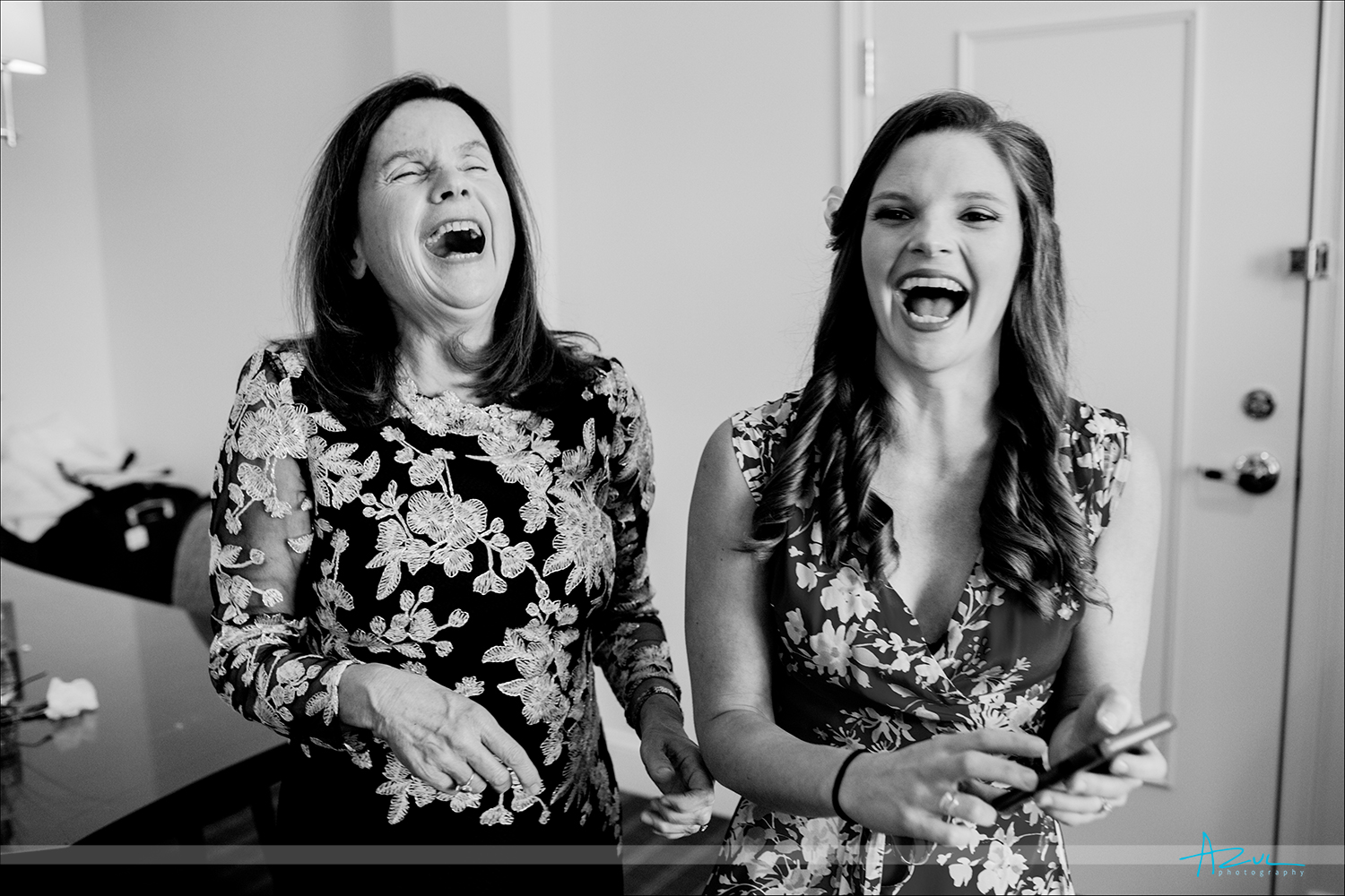 Mother and bride wonderful laughing moment getting ready in Chapel Hill, NC