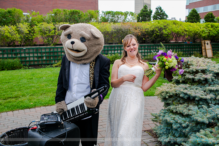 Fun wedding day portrait with the bride and the musicians in Boston Keytar Bear