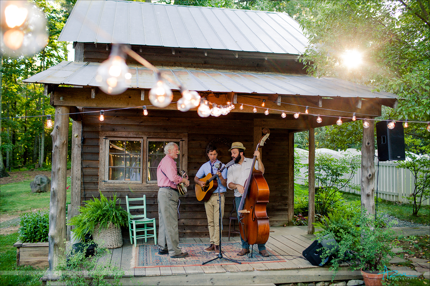 Wedding day cocktail hour music during sunset at Rock Quarry Farm in Chapel Hill