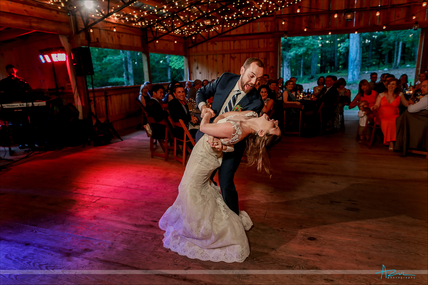 Photography of the first dance ending with the groom dipping the bride at the end at Rock Quarry Farm in North Carolina