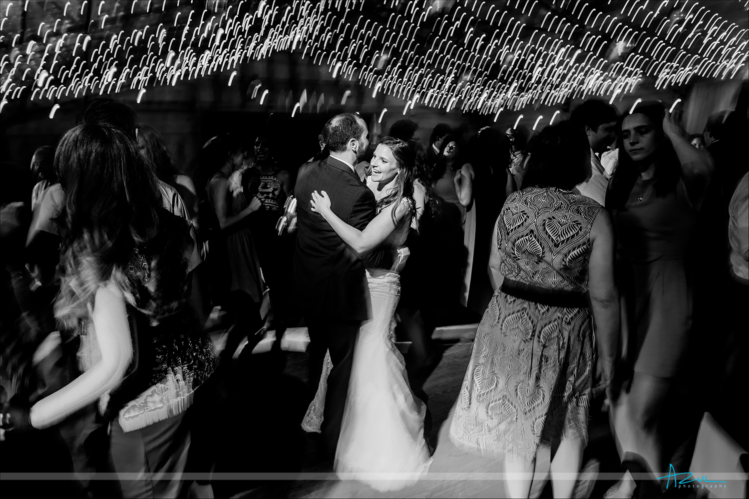 Slow shutter creative wedding photography in low light conditions inside a barn in Chapel Hill.