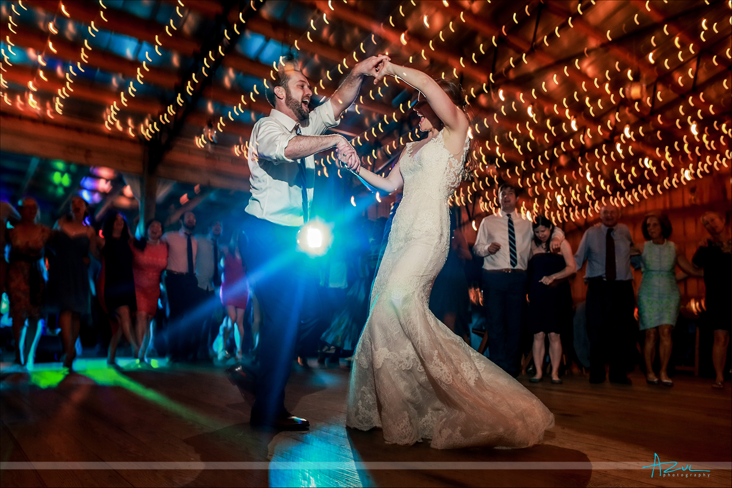 Image of the bride and groom's last dance with motion blur created by the photographer in Chapel Hill NC at Rock Quarry Farm