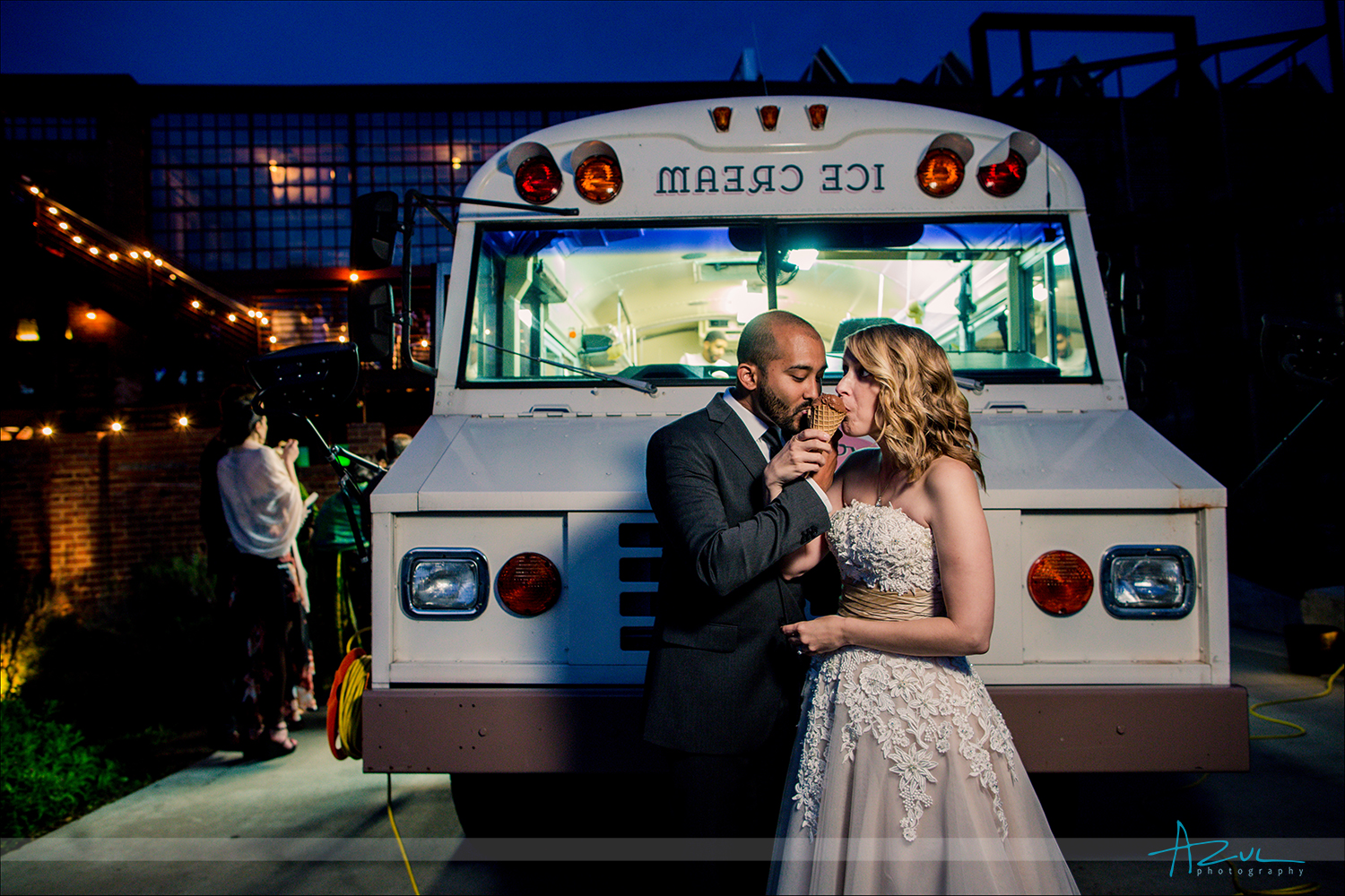 Photographer captures the wedding day couple sharing a toast with ice cream after the ceremony in Raleigh NC